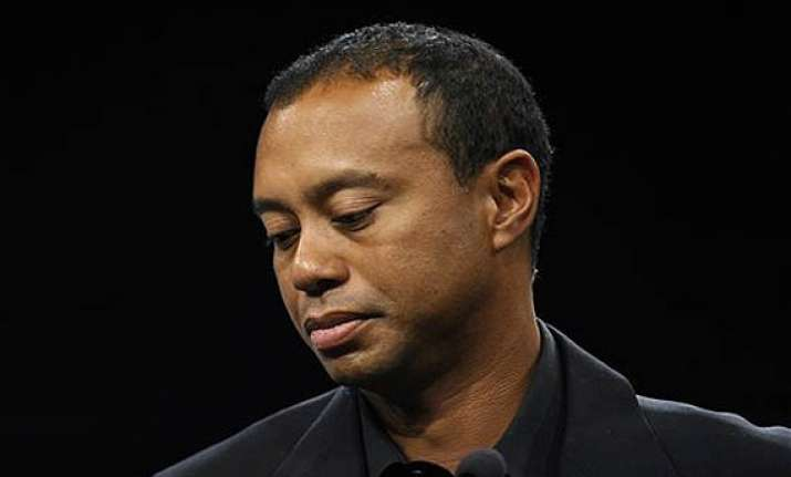 tiger woods says he s healing slowly from back surgery
