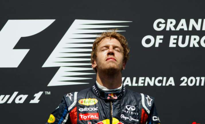 with little drama vettel easily wins f1 title