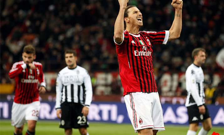 ac milan moves top with 2 0 win over siena