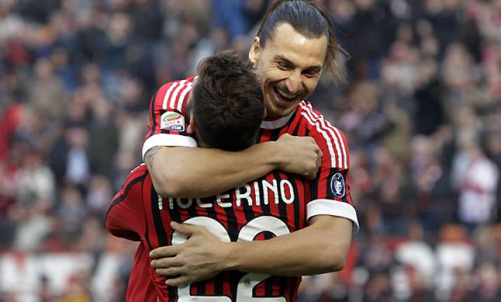 ac milan opens up 4 point lead on juve in serie a