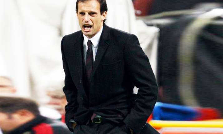 allegri says milan is fighting for title at roma