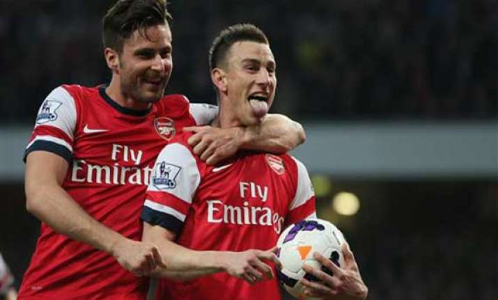 arsenal beats newcastle 3 0 to cement fourth spot
