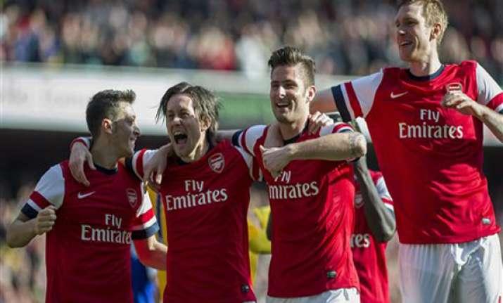 arsenal into fa cup semis united wins in league