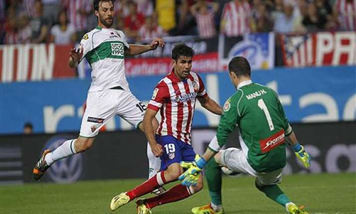 atletico madrid extends liga lead before chelsea cl match