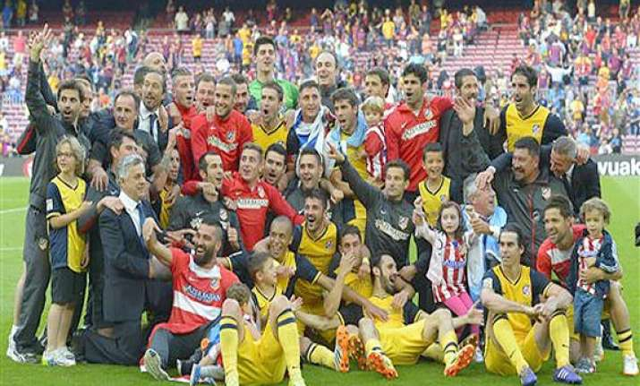 atletico madrid wins spanish title with 1 1 draw against