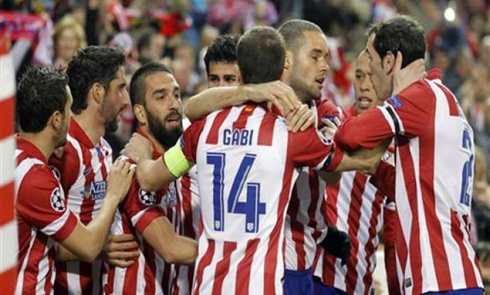 atletico beats milan 4 1 to reach champs quarters
