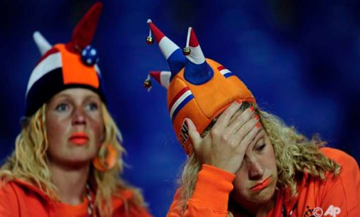 badly shaken dutch now look to 2014 world cup