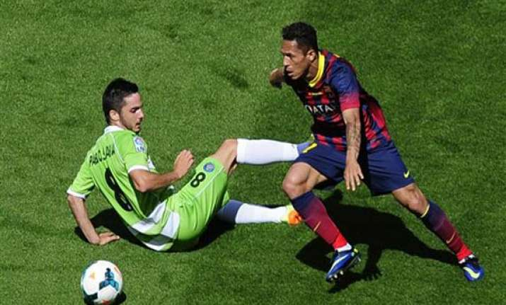 barca s title defense hit by 2 2 draw with getafe