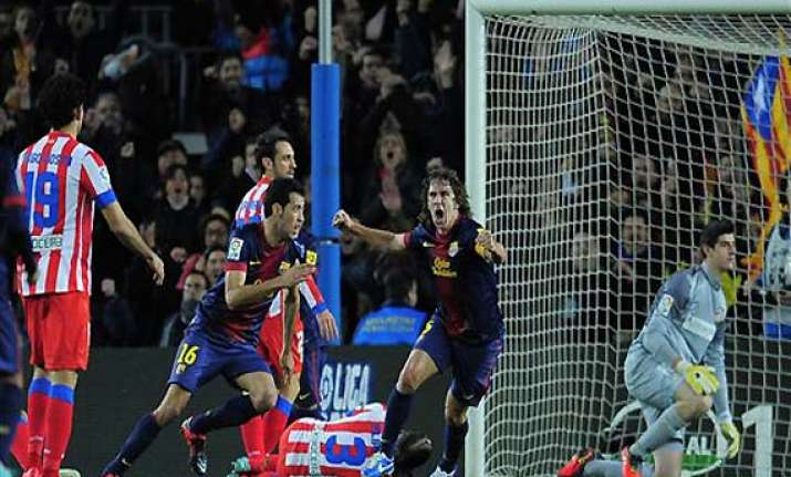 barca crush atletico madrid to go nine clear in spain