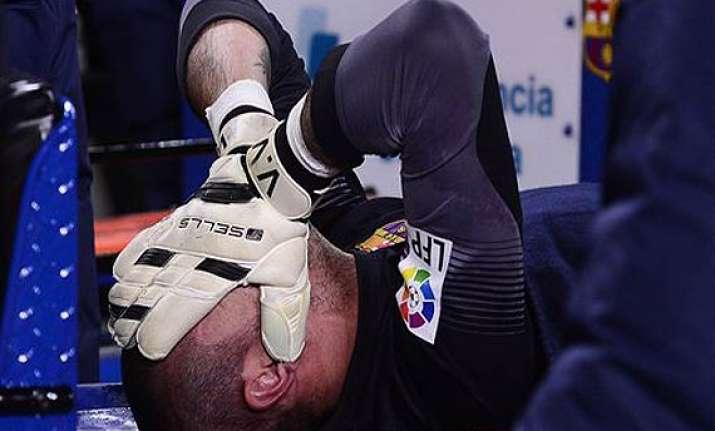 barcelona goalkeeper victor valdes tears knee ligament.