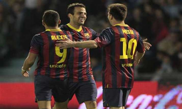 barcelona wins 3 0 at celta extends lead