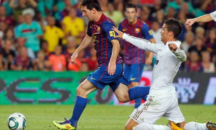 barcelona beats madrid with messi s goal