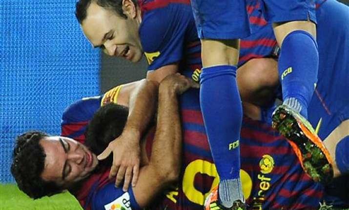 barcelona bounces back with 4 0 win over rayo