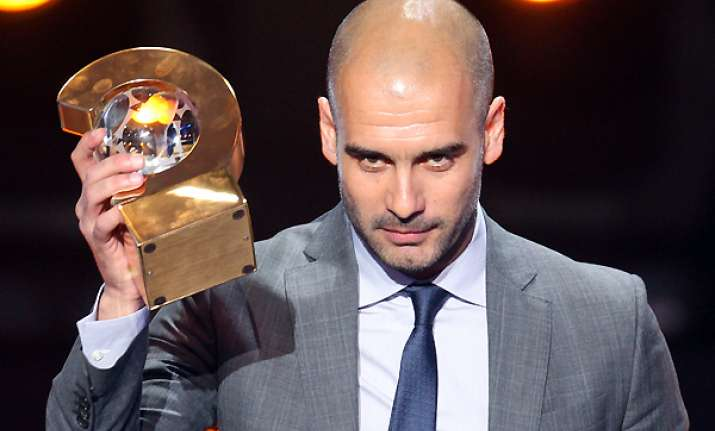 barcelona s guardiola wins fifa best coach award