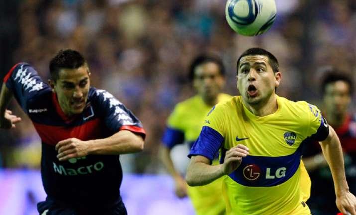 boca stays on top in argentina despite draw