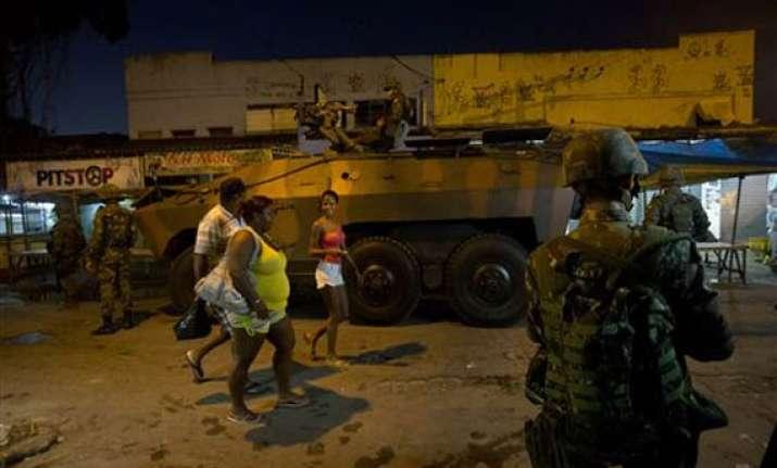 brazil security forces raid rio slum before wcup