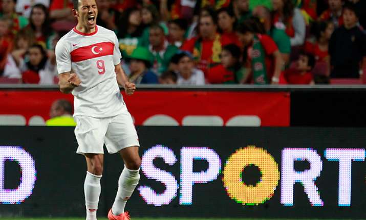 bulut scores twice as turkey upsets portugal 3 1