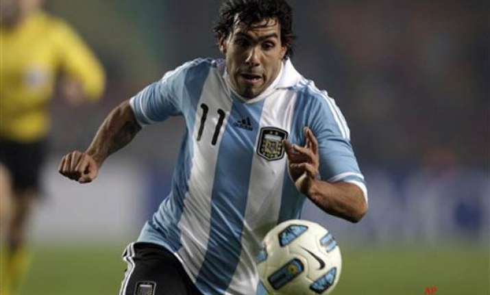 carlos tevez to quit manchester city