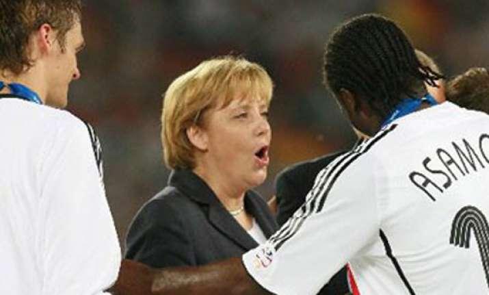 chancellor angela merkel to visit german team