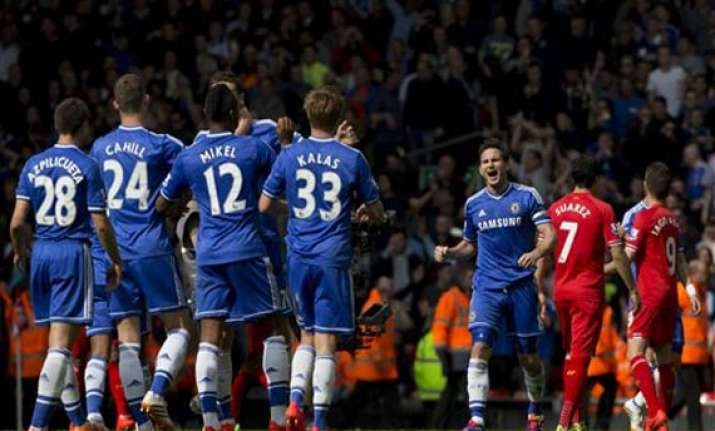 chelsea dents liverpool hopes with anfield win