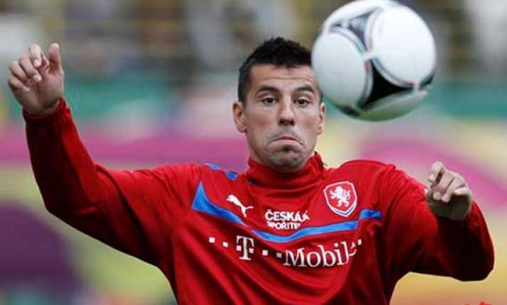 czech striker milan baros to undergo muscle scan