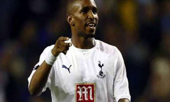 defoe retained by england shaw gets 1st call up