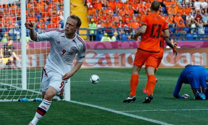 denmark stuns netherlands 1 0 at euro 2012