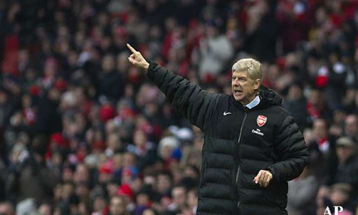 despite title drought arsenal commits to prudence