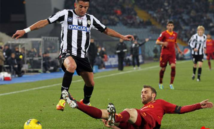 di natale helps udinese beat roma 2 0
