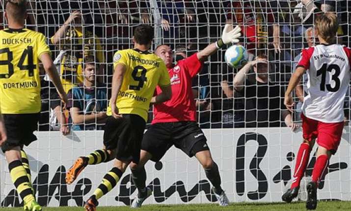 dortmund leverkusen progress in german cup