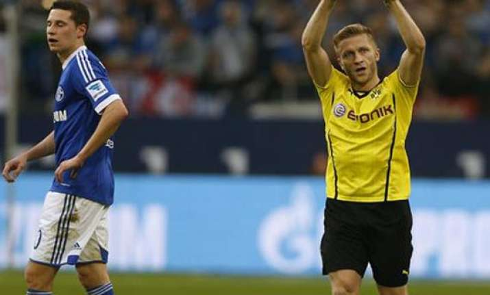 dortmund wins ruhr derby with 3 1 win at schalke
