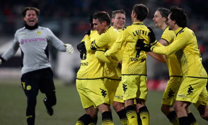 dortmund wins 2 0 to move ahead in bundesliga