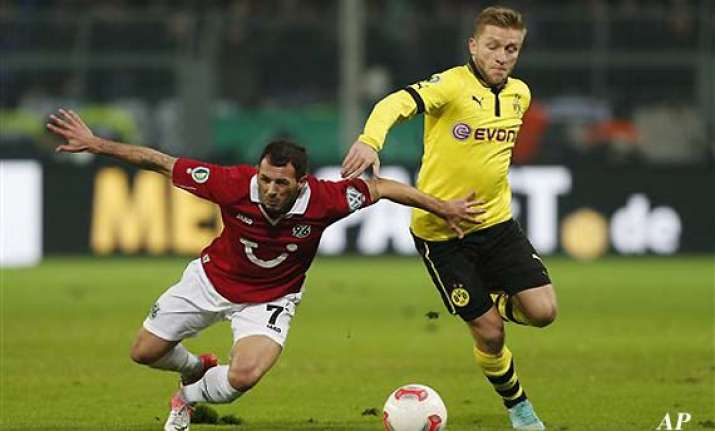 dortmund routs hannover 5 1 bayern up next