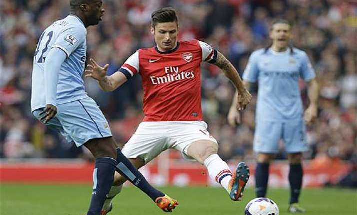 epl arsenal prevents man city going top with 1 1 draw.