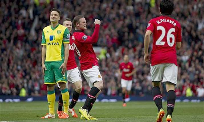 epl man united beats norwich 4 0 as giggs takes charge