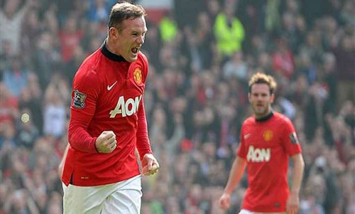 epl rooney double powers man united to win over aston villa.