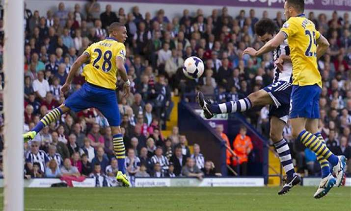 english premier league west brom holds arsenal to 1 1 draw