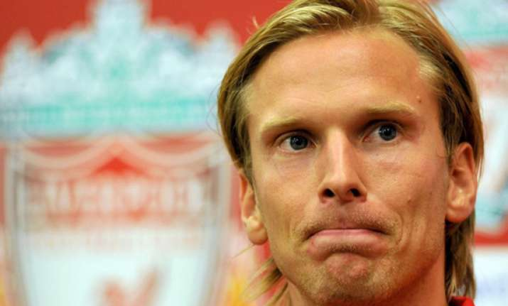 evian signs christian poulsen from liverpool