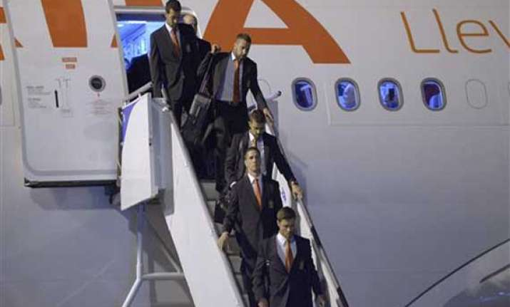 fifa world cup spain lands in brazil to begin title defense