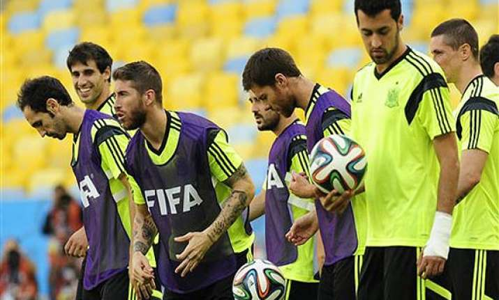 fifa world cup spain drops xavi pique for must win against
