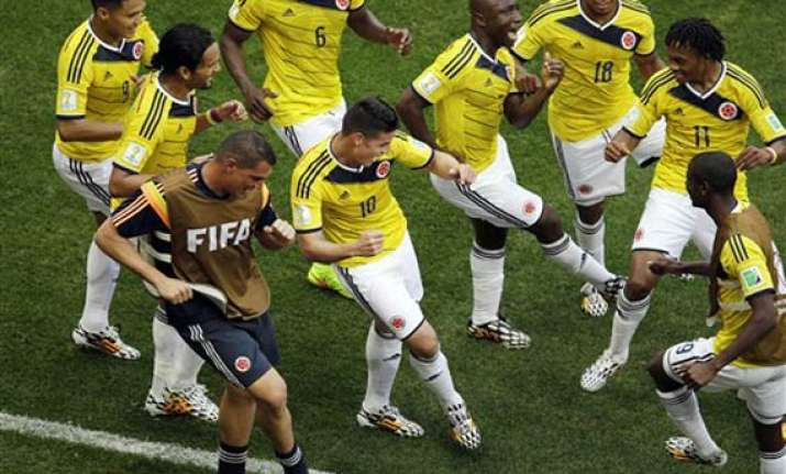 fifa world cup colombia beat ivory coast 2 1 in a gripping