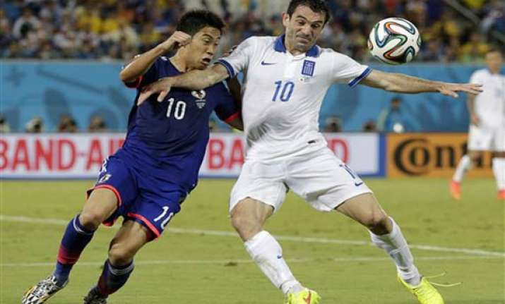 fifa world cup scoreless draw keeps japan and greece alive
