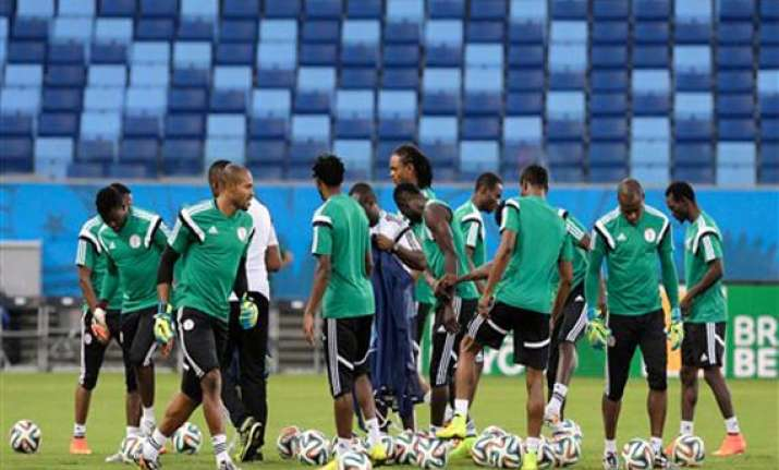 fifa world cup nigerians seek world cup win to lift somber