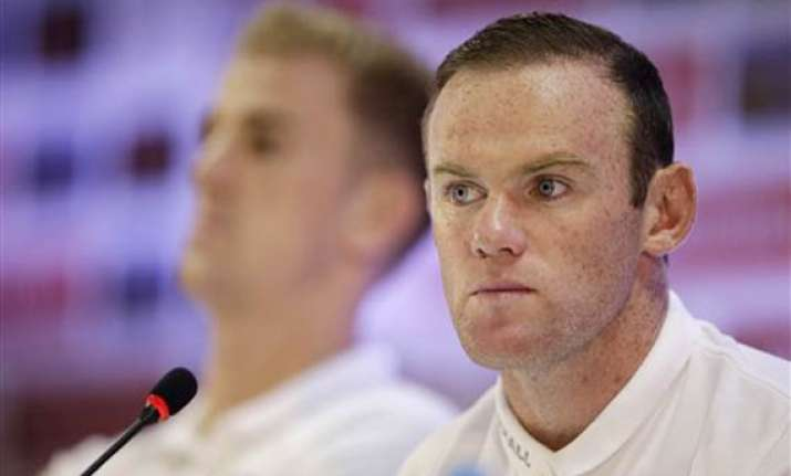 fifa world cup wayne rooney apologizes to fans after
