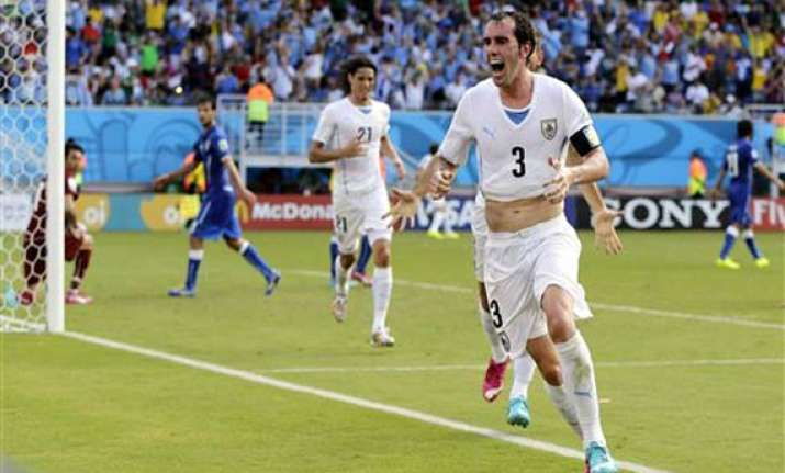 fifa world cup uruguay edges italy 1 0 to advance to next