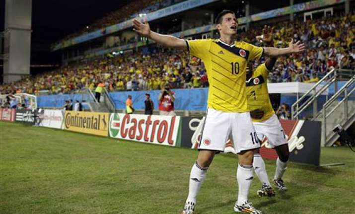 fifa world cup colombia tops group c by beating japan 4 1