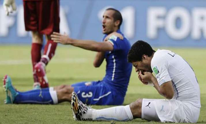 fifa world cup five controversies in luis suarez s career
