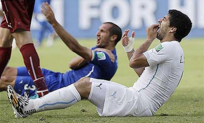 fifa world cup uruguay defends suarez as fifa scrambles