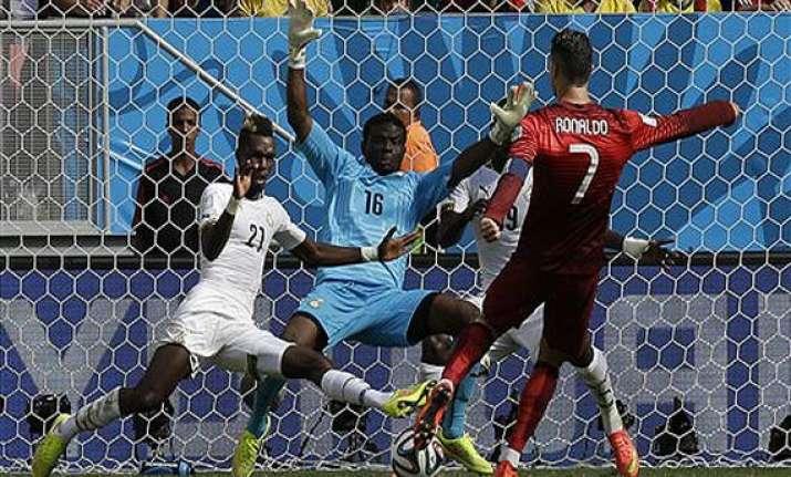 fifa world cup ronaldo earns portugal 2 1 win against ghana