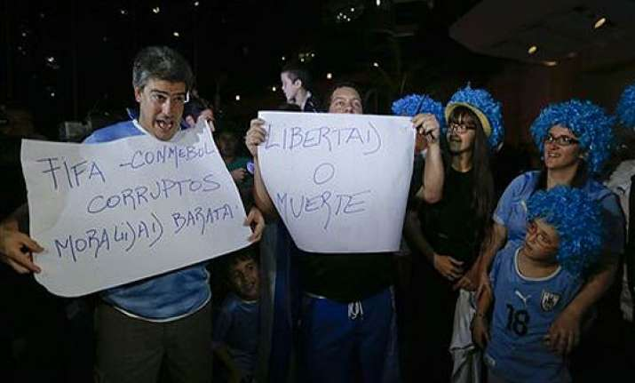 fifa world cup uruguayan soccer fans wait for banned suarez